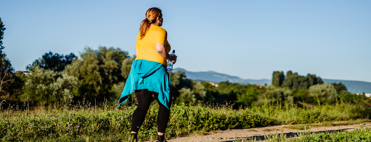Young Overweight Woman Running