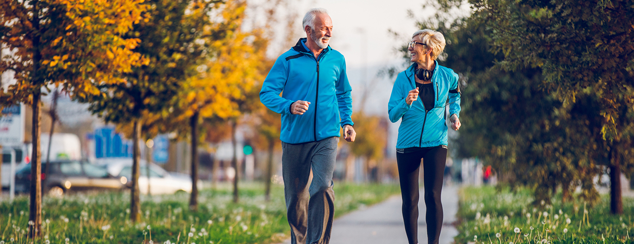 Senior Couple in Sports Clothing Jogging Together