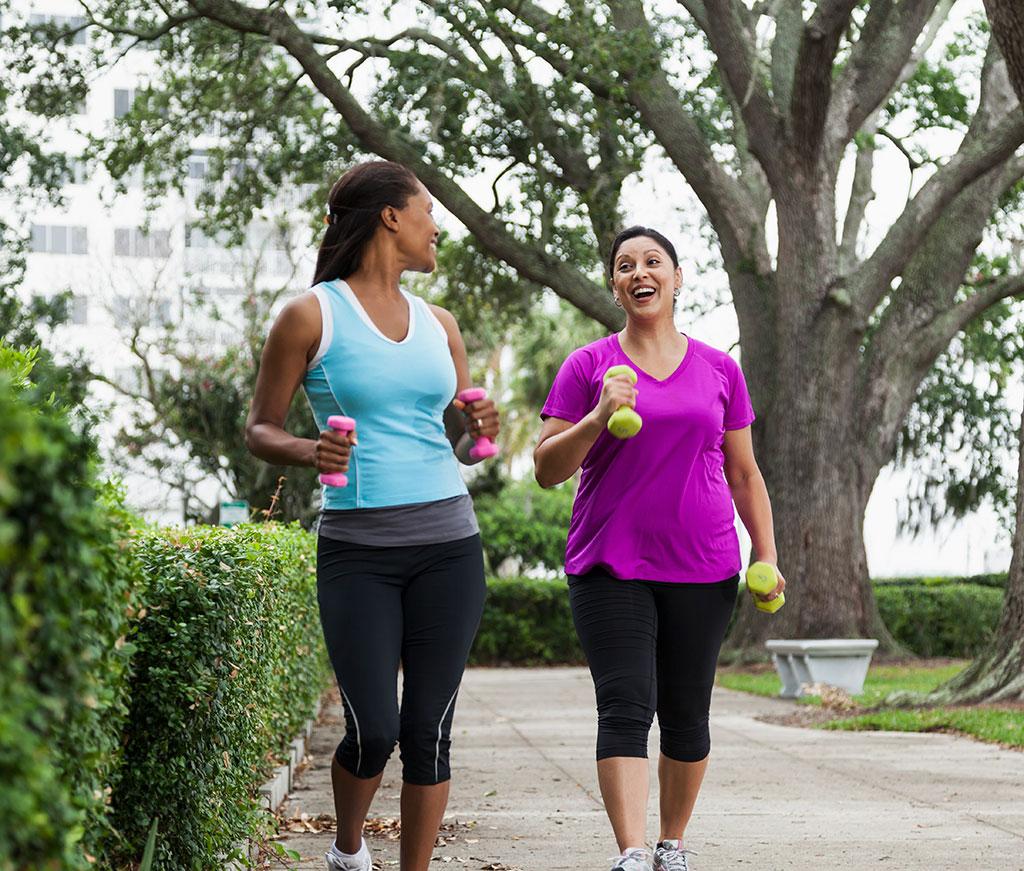 Women exercising in park